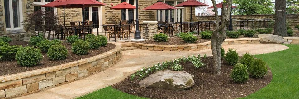 New stone walls, new paver walkway and new landscaping refresh this historic commercial property!