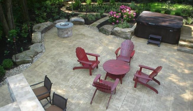 Multiple stone patio and bar area.