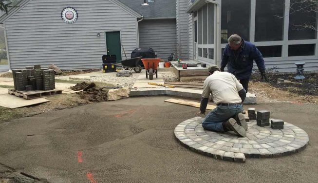Installing an intricate circular pattern stone patio