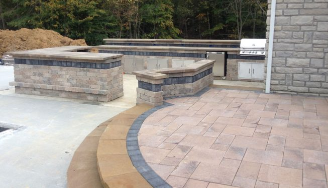 Intricately Cut Stone Work in these curved steps leads to the lower stone patio level.