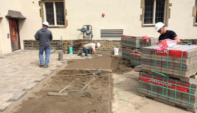 Workers laying the New Stone Courtyard at the Granville Inn